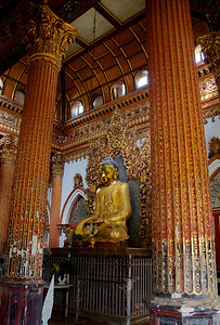Buddha Statue Amidst Decorative Columns