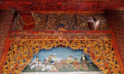 Painting and Carved Wood Decorations Above a Doorway