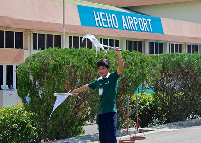 Man Waving Passengers to the Terminal