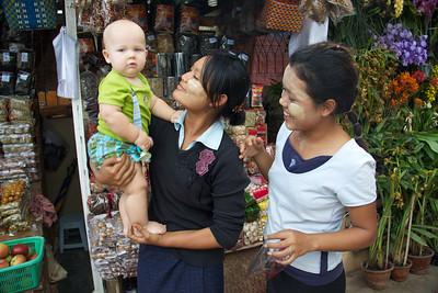 Local Women Admiring Caucasian Baby