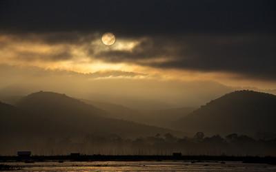 Sunrise and 99-Percent Full Moon