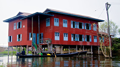 House on Stilts and Famly's Boat for Transportation