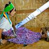 Padaung Girl And Backstrap Weaving Loom<br /> Inn Shwe Village<br /> <br /> Inle Lake, Burma<br /> 30 October 2012