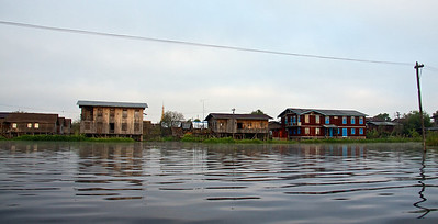 Electricity Pole and Houses