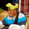 Male Vendor Smoking A Cheroot (Cigar)