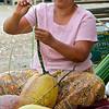 Vendor Braiding a Coconut Vine