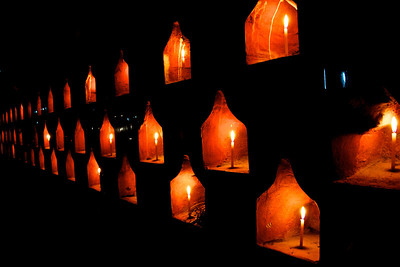 Candles Lit along Exterior Wall