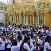 Women Parading Past Temples<br /> Shwedagon Pagoda<br /> <br /> Yangon, Burma<br /> 23 June 2013