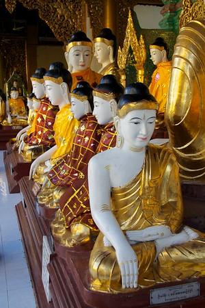 Buddha Statues All In A Row<br /> Shwedagon Pagoda<br /> <br /> Yangon, Burma<br /> 5 October 2013