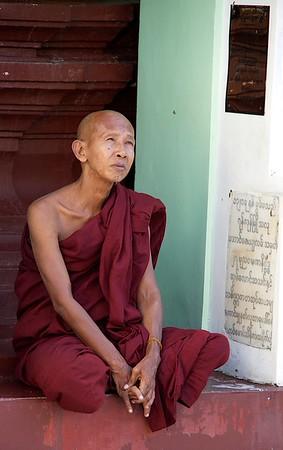 Buddhist Monk Contemplating<br /> Shwedagon Pagoda<br /> <br /> Yangon, Burma<br /> 5 October 2013