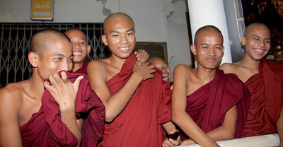 Young Adult Buddhist Monks Sharing Smiles and Laughter With Us