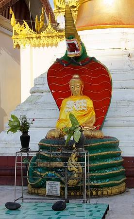 Buddha Sitting On Serpent<br /> Shwedagon Pagoda<br /> <br /> Yangon, Burma<br /> 5 October 2013