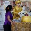 Pouring Water On Statue<br /> Shwedagon Pagoda<br /> <br /> Yangon, Burma<br /> 5 October 2013