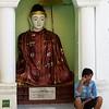 Man Talking On Cellphone Outside A Shrine<br /> Shwedagon Pagoda<br /> <br /> Yangon, Burma<br /> 5 October 2013