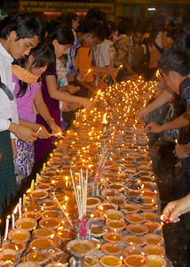 People Lighting Candles