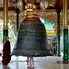 Monk Examining Singu Min Bell<br /> Shwedagon Pagoda<br /> <br /> Yangon, Burma<br /> 29 July 2012