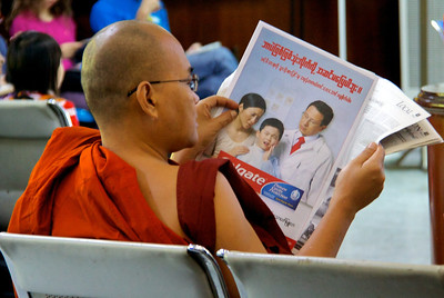 Monk Reading a Newspaper