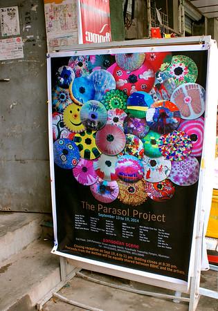 Poster At Entrance<br /> The Parasol Project<br /> <br /> Pansodan Scene<br /> Yangon, Burma<br /> 19 September 2014