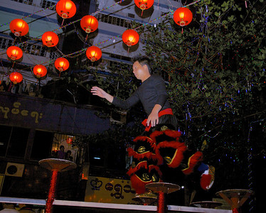 Lion Dancer Testing Pedestals Before the Performance