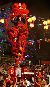 Two Lion Dancers Standing on One Foot
