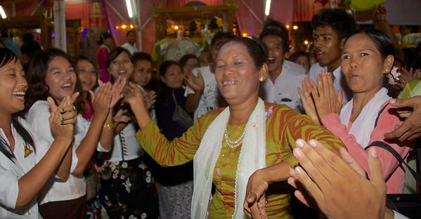 Weaving Team Supporters Chanting and Dancing