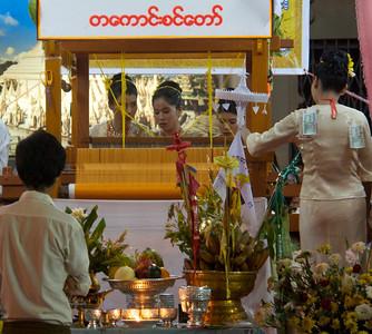 Mahoe Robe Weaving Competition  Note: Green K1,000 money bills pinned on team assistant.  Shwedagon Pagoda Yangon, Burma 27 November 2012