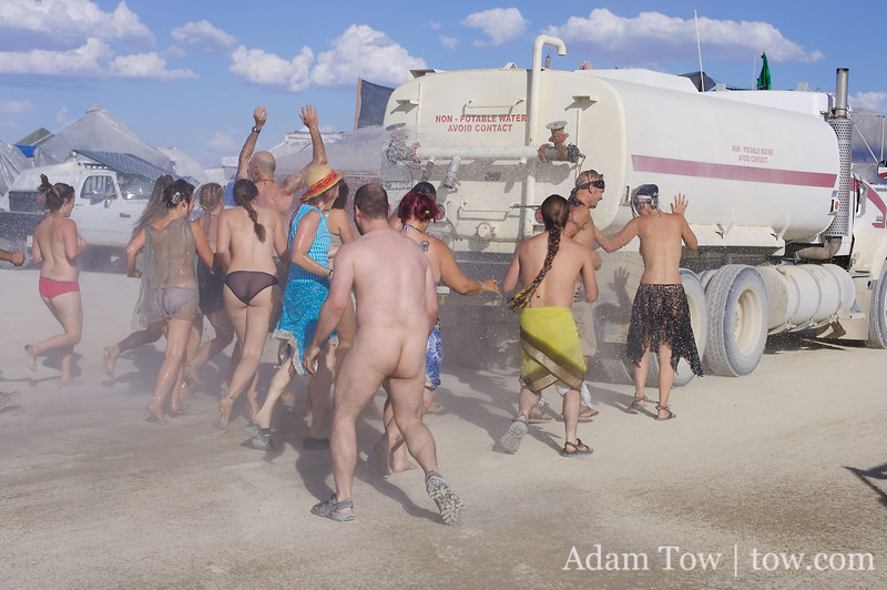 Taking a shower, courtesy of the water truck at Burning Man 2007.
