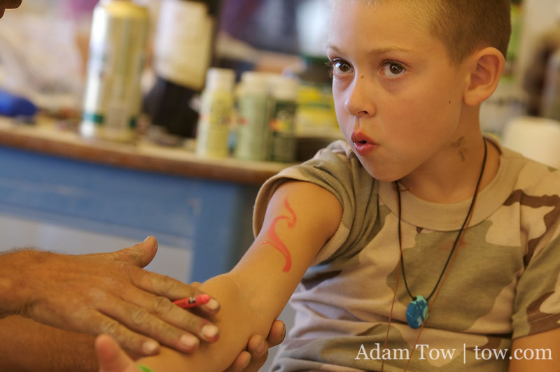 Getting his arm painted