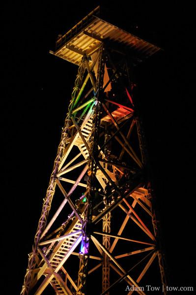 Crude Awakening, lit up at night