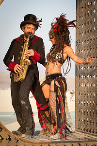 An energetic couple jives to some early morning tunes at sunrise.