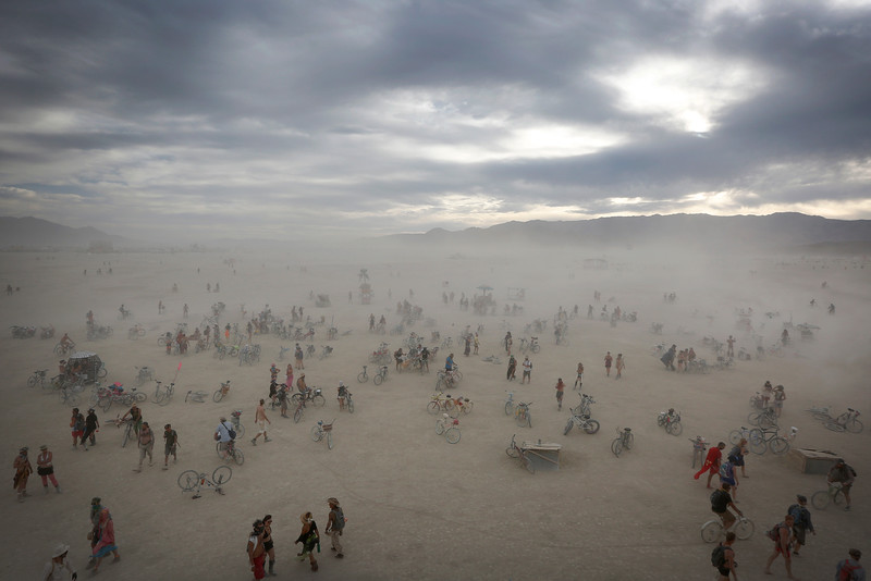 Attendees travel across the playa during the annual Burning Man festival in Black Rock Desert, Nev. on Sept. 1, 2016.