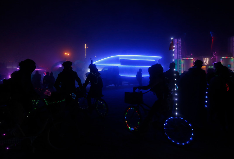 Attendees ride their bikes on the playa during the annual Burning Man festival in Black Rock Desert, Nev. on Sept. 3, 2016.