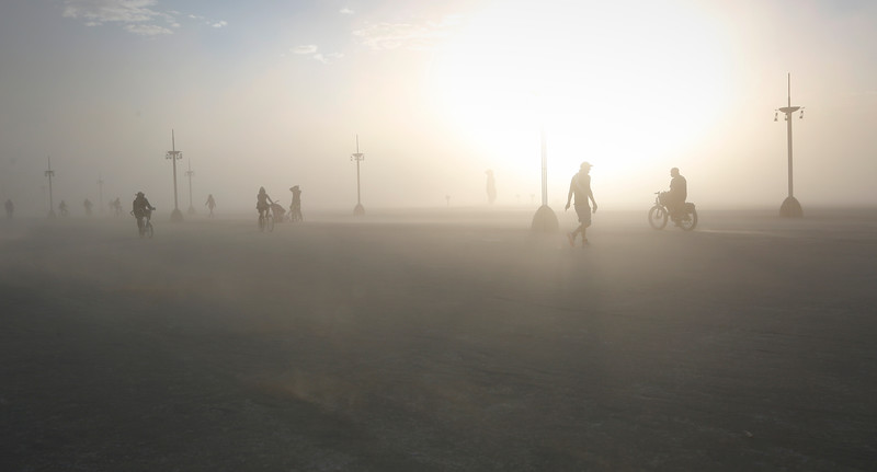 Participants walk across the playa during the annual Burning Man festival in Black Rock Desert, Nev. on Sept. 4, 2016.