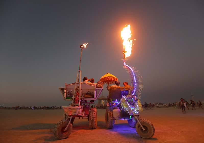 Two art cars wait for the annual burning of the Man during the annual Burning Man arts and music festival in Black Rock Desert, Nev. on Sept. 2, 2017.