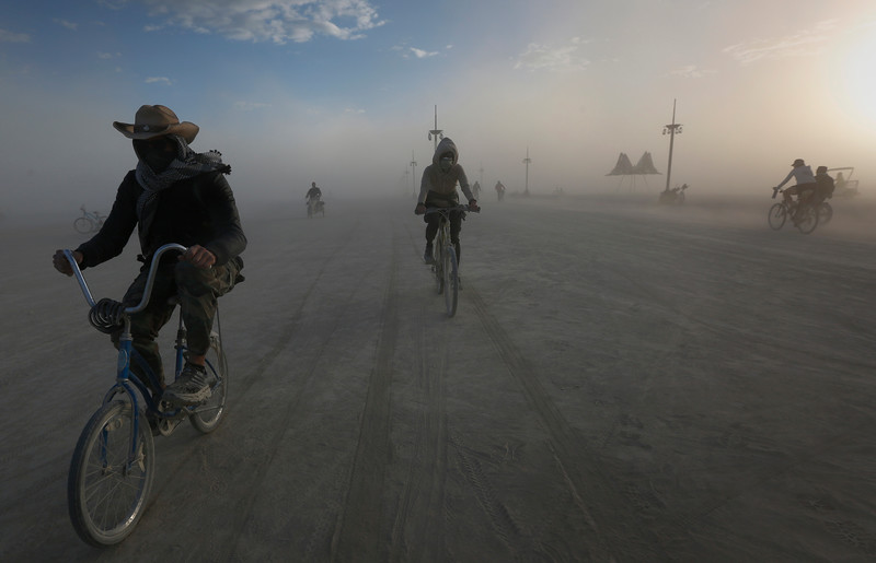 Participants ride across the playa during the annual Burning Man festival in Black Rock Desert, Nev. on Sept. 4, 2016.