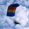 "Paraplane by Lora Mosier<br /> <br /> It's also called a Powered Parachute. <br /> <br /> Personally, I think it's a flying lawn mower and I'm pretty sure there's some flubber involved.<br /> <br />  <a href=""http://www.burningriverboutique.com"">http://www.burningriverboutique.com</a>"
