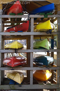 Canoes' Colorful Cousins by Lora Mosier  Patiently waiting their turn to go back in the water.  Taken at the boat launch in Avon Lake, OH  www.burningriverboutique.com