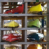 "Canoes' Colorful Cousins by Lora Mosier<br /> <br /> Patiently waiting their turn to go back in the water.<br /> <br /> Taken at the boat launch in Avon Lake, OH<br /> <br />  <a href=""http://www.burningriverboutique.com"">http://www.burningriverboutique.com</a>"