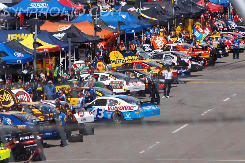 "I'm In The Pits by Lora Mosier<br /> <br /> Looking down the pits during NASCAR Sprint Cup Practice at the Sharpie 500 race in Bristol, TN.<br /> <br /> The pit stop is my favorite part of the race.  It just boggles my mind how fast those guys move.<br /> <br /> <br />  <a href=""http://www.burningriverboutique.com"">http://www.burningriverboutique.com</a>"