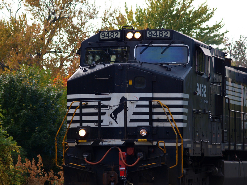 "Rule 14L by Lora Mosier<br /> <br /> As the Man in Black sang, ""We heard that train a comin'""; and pulled up to the crossing in Vermillion, Ohio just in time to catch Norfolk & Southern #9482 coming through town.<br /> <br /> Johnny Cash had a song about trains on every one of his albums. <br /> <br />  <a href=""http://www.burningriverboutique.com"">http://www.burningriverboutique.com</a>"