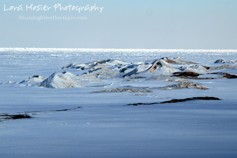"Lake Landscape by Lora Mosier<br /> <br /> This is Lake Erie (at least my little corner of it) in February.  <br /> <br /> I just can't get over how the snow covered, frozen waves look like miniature mountains.  <br /> <br /> <br />  <a href=""http://www.burningriverboutique.com"">http://www.burningriverboutique.com</a>"