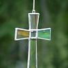 "Amazing Grace by Lora Mosier<br /> <br /> As this stained glass cross sways in the breeze, it causes the pipes creating the wind chime above it to play the most beautiful tones that are reminiscent of the melody of the song ""Amazing Grace"". <br /> <br />  <a href=""http://www.burningriverboutique.com"">http://www.burningriverboutique.com</a>"