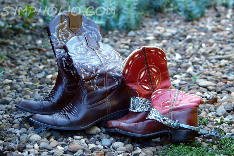 "Mamas Don't Let Your Babies Grow Up to Be Cowgirls by Lora Mosier<br /> <br /> From the dairy farm to the beach, with the sidewalks and stone paths in between, these boots have covered a lot of ground.<br /> <br />  <a href=""http://www.burningriverboutique.com"">http://www.burningriverboutique.com</a>"