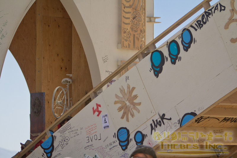 """Blue """"critters"""" painted onto the Temple of Transition"""