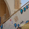 "Blue ""critters"" painted onto the Temple of Transition"