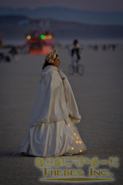 A participant wears white on Thursday at dawn