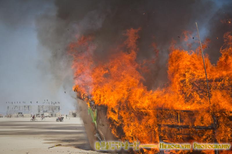 Cap'n Jim Memorial burn. First day time art burn at Burning Man.