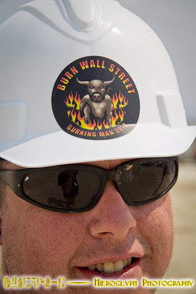 A crew member for the Burn Wall St. Project