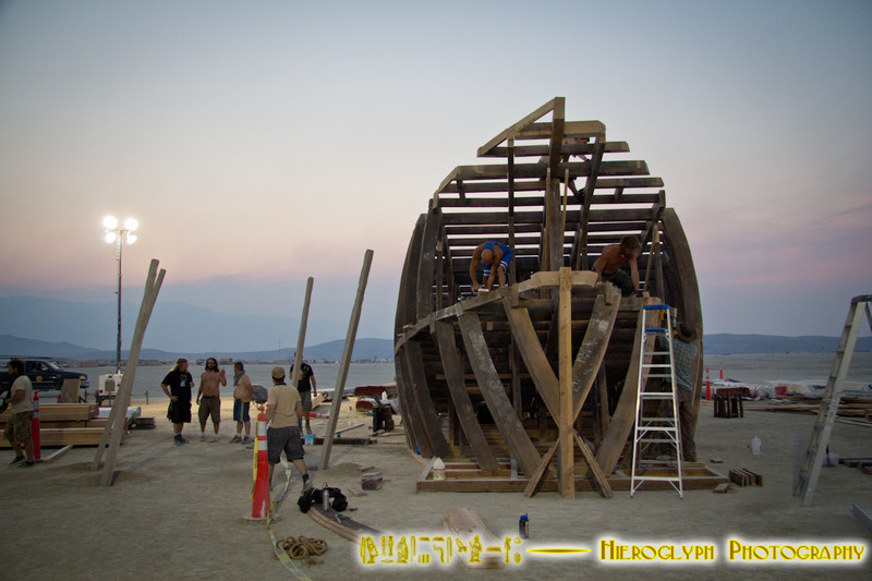 The Pier crew works on the addition to their project at dusk.