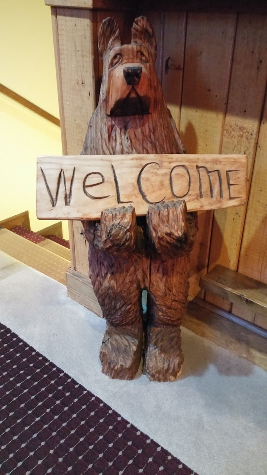 Wooden carved WELCOME bear.